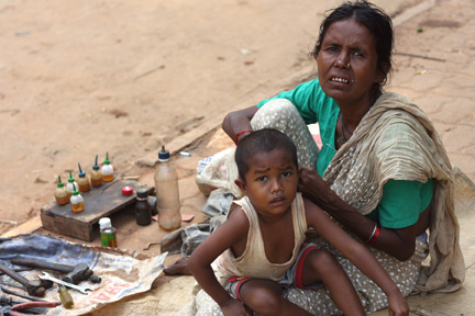 Rickshaw Mechanic and child.