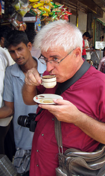 Tea drinking camerist being watched.