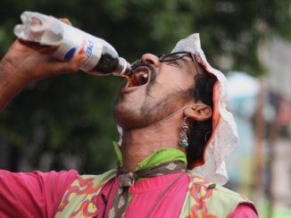 Bengalis sure know how to drink from a bottle without touching it to their lips!