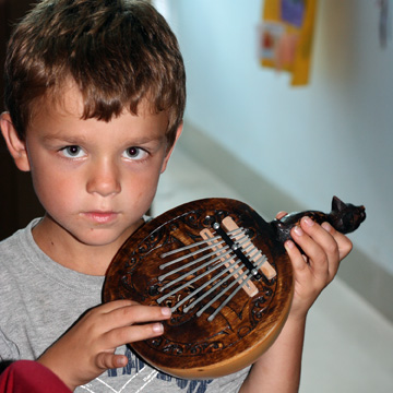 Musician proud of his new instrument.