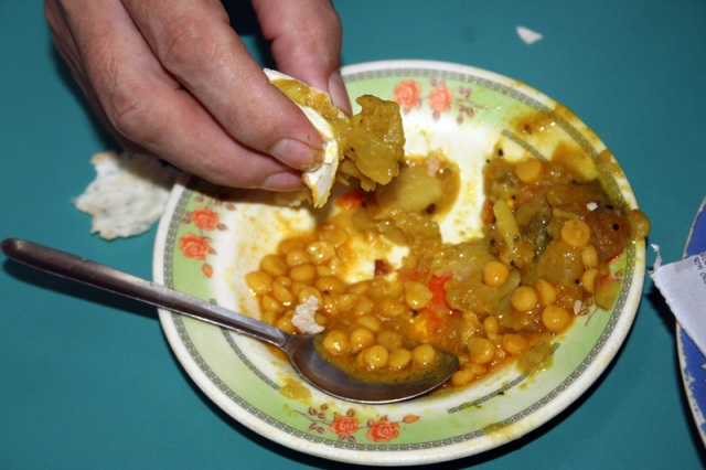 Who needs a spoon when you can grab the food with a piece of ruti!