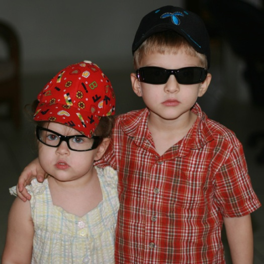 Proudly wearing their new glasses and caps!