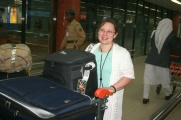 Carol With Her Luggage and a Big Smile on Her Face!