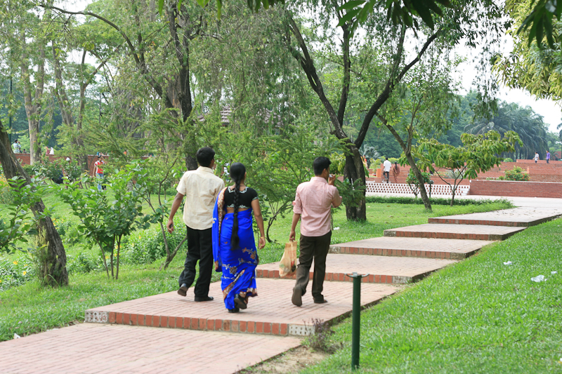 BRIGHT BLUE SARI STANDS OUT SHARPLY AMONGST THE GREENERY!