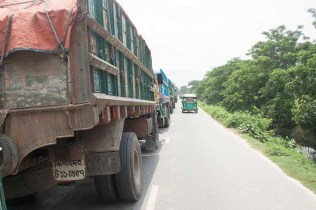 TRUCKS WAITING TO CROSS INTO INDIA