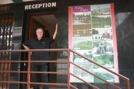 Here I am at Entrance Beside Photos Showing Places to Visit.
