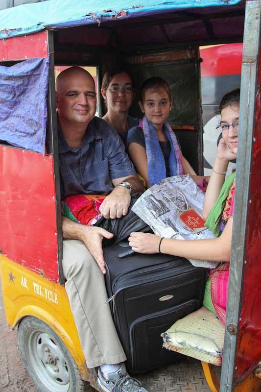 Squeezed into a auto-rickshaw.