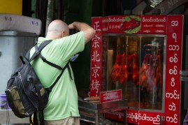 Craig photographing barbecued chicken in Myanmar.