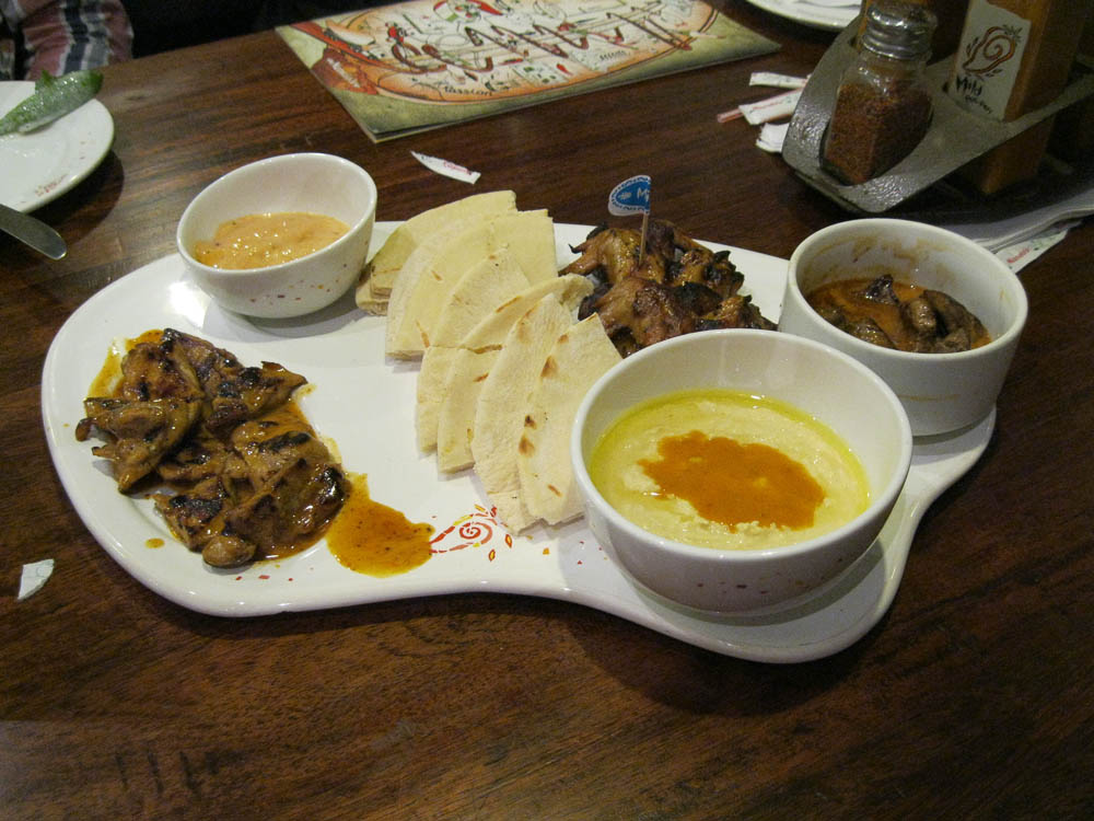 Appetizer Plate With Livers, Wings, Thighs, Humus, etc.