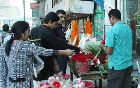 Flower Vendor selling lots of flowers!