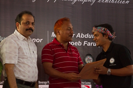 Guest of Honor, Shoeb Faruquee handing out an award.