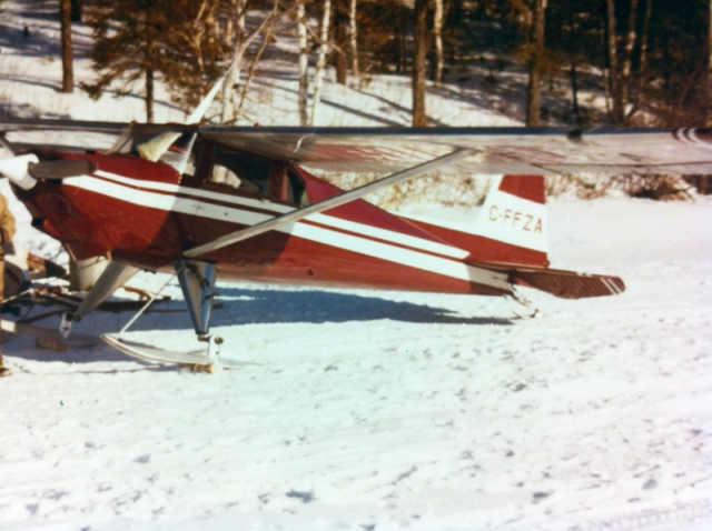The plane I flew in NW Ontario, parked on the lake and ready to go.
