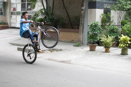 Bicyclist with Blue Shirt