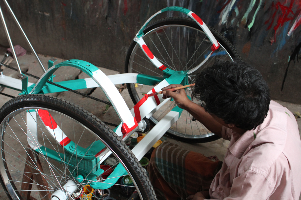 Artist at Work Painting a New Rickshaw