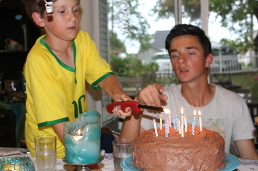 Little brother lighting the candles.